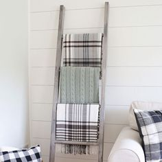 How to easily build a DIY blanket ladder. This $15 DIY blanket ladder is easy to build, provides a practical way to store blankets, and it's super cute too!
