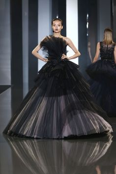 A model walks the runway during the Ralph & Russo show as part of Paris Fashion Week - Haute Couture Fall/Winter 2014-2015 at Pavillon Cambon Capucines on July 10, 2014 in Paris, France. - 11 of 136