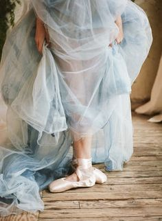 This Butterfly Ballet Boudoir Session from Archetype features a handmade blue silk tulle skirt and lace robe from Gossamer.