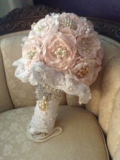 Hand made fabric flowers and beaded lace. Now onto the next tutorial. If you like this brooch bouquet. I am making custom bouquets and you can contact me at lisalalcorn@yahoo.com or I am on etsy as well
