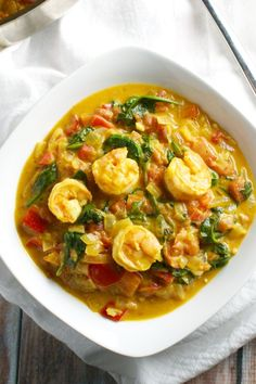 Coconut Shrimp Curry is made in one pot and takes just 30 minutes. It's full of flavor and vegetables like red pepper and spinach.