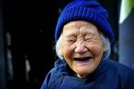 What a great picture of an elderly woman. I LOVE this smile!