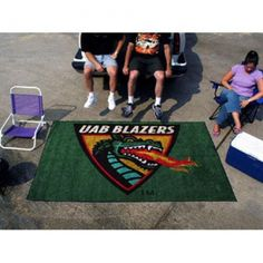 """Alabama Birmingham Blazers NCAA Ulti-Mat"""" Floor Mat (5x8')"""". Each Fan Mats product is produced in a 250;000 sq. ft. state-of-the art manufacturing facility. Only the highest quality; high luster yarn with 16 oz. face weight is used. These mats are chromo jet printed; allowing for unique; full penetration of the color on the machine washable non-skid Duragon latex backing with a sewn edge  - making for a beautiful and lasting piece for even the most aggressive fan.  Anything else would be…"""