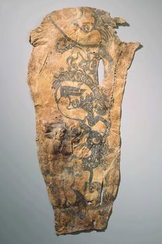 """Some of the most spectacular tattoos in the ancient world have been found adorning Iron Age mummies unearthed in the Altay Mountains of Siberia. There, a series of tombs dug into permafrost preserved the remains of nobles from a nomadic people today known as the Pazyryk Culture. On the skins of these mummies were intricate tattoos, depicting both mythical and real animals in action: running, stalking victims, or twisting in an S-shape, which scholars call """"the pose of agony."""""""