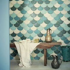 Fish scale tiles are a great way to update your kitchen or bathroom. Replace your subway tile with fish scale tile to stay on trend. For more design ideas and inspiration, go to Domino. Bad Inspiration, Bathroom Inspiration, Interior Inspiration, Sweet Home, Fish Scale Tile, Bohemian Bathroom, Moroccan Tiles, Moroccan Bathroom, Moroccan Garden