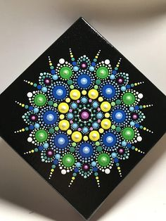 """Hand painted with acrylic in Yellow, Blues, Green, and Teal. Sprayed with a high gloss sealer to protect the colors. Canvas size is 5"""" X 5""""."""