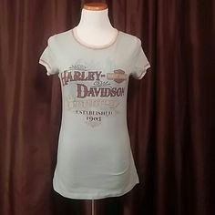 """Ladies HARLEY DAVIDSON Short Sleeve Tshirt Brand: Harley Davidson from Boswell's Nashville Color: Very, very light blue with Ivoer around the neck & sleeves Size: Large Condition: Excellent pre-loved condition Measures 16.5"""" armpit to armpit & 26"""" from shoulder to hem. Harley Davidson Tops Tees - Short Sleeve"""