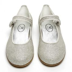 This strap shoe is made of a fabulous glitter leather. Choose from black, silver or platinum glitter. Very cool as a party shoe, but fun under any outfit. Strap on a popper, rubber sole. Winter Shoes, Summer Shoes, Girls Wedding Shoes, Black Tights, Party Shoes, Kid Shoes, Silver Glitter, Grosgrain, Slippers