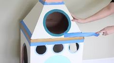 How To Make A Cardboard Rocket Ship For Your Cat Using Old Boxes | Cuteness Cardboard Crafts Kids, Cardboard Rocket, Cardboard Boxes, Buzz Lightyear Wings, Cat Castle, Diy Rocket, Cat Hammock, Fancy Cats, Baby Box
