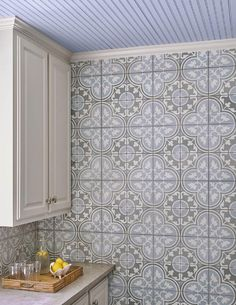 Beneath a purple beadboard ceiling, Cement Tile Shop Bouquet Tiles complement white cabinets finished with polished nickel knobs and a concrete countertop. Cement Tiles Bathroom, Marble Bathrooms, Bathroom Countertops, Backsplash, Kitchen Designs Photos, Purple Kitchen, Flooring, Interior Design, Berry