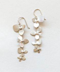 Want! Delicate florals coated in fine sterling silver swing gently for the perfect refined earring #GiftWell