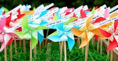 Bright colors and whimsical shapes make these pinwheel table cards a must for an outdoor wedding.