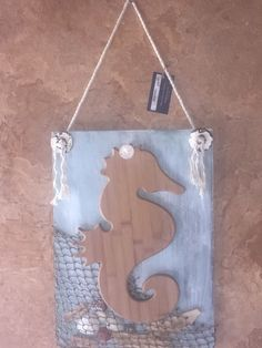 Wooden seahorse cutting board wall hanging nautical decor, seashells, fish net by AwsomeAccents on Etsy https://www.etsy.com/listing/293143405/wooden-seahorse-cutting-board-wall