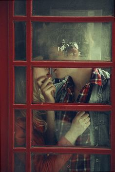 Need to find a red phone booth and a beautiful couple.
