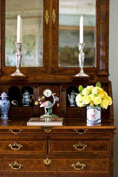 Antiqued glass highlights this antique secretary - Traditional Home® / Photo: John Bessler / Design: Janet Simon