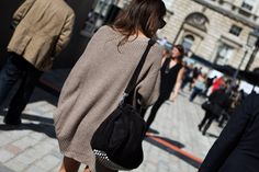 oversized sweater and studded bottom bag.