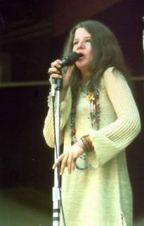 Janis Joplin at Monterey Pop Festival  in gold Colin Rose tunic & pants