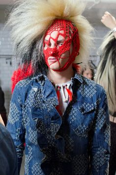 A knitted love letter to anarchists and misfits in bright pom poms and knit face masks at Sibling SS15, London Collections: Men. More images here: http://www.dazeddigital.com/fashion/article/20350/1/sibling-ss15