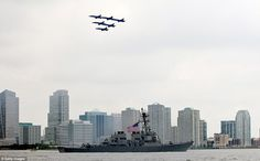 The US Navy Blue Angels fly in formation as they pass over the USS Donald Cook on the Hudson River during the Parade of Ships for the start of Fleet Week. It concludes on Memorial Day with a military flyover to honor those killed while serving in the military. (Photo by Allison Joyce/Getty Images