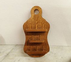 Where can you buy a VINTAGE GOLDEN OAK WOOD 8 THIMBLE DISPLAY? Here and its perfect for your prize thimble collection. This wall display shelf is made of SOLID Golden Oak wood and has three shelves with dowels thatll hold 8 thimbles. A big hole at the top is big enough to slip a ribbon through to hang. This would make a GREAT HOUSEWARMING gift. https://www.etsy.com/listing/483251321 $22.95
