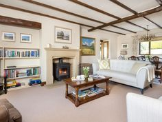 Check into this luxury holiday cottage in Ireby. Enjoy stylish, open plan living in this beautiful home. Featuring a wood burner, oak beams, elegant decor and sumptuous sofas! Gather around the dining table and retire to the sitting area.