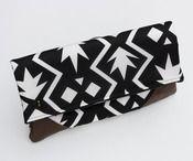 foldover clutch in black + white graphic print