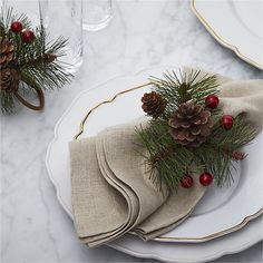 ShipIn stock and ready to ship Pickup in StoreSelect Store Add to FavoritesPrint this PageEmail a link to this page to someone Overview Festive napkin ring bundles natural pinecones and crafted berries and pine sprigs to bring the forest to the holiday table.