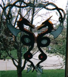 Suncatcher of two water dragons in the Celtic style