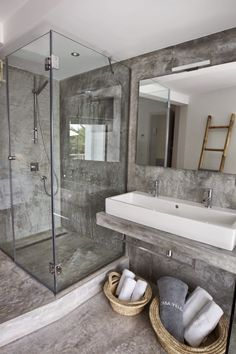 Concrete Countertop concrete countertops marble and concrete bathroom - Give your bathroom countertops a stylish update! Here are 14 reasons to use concrete counters in your bathroom. For more design trends, head to Domino.