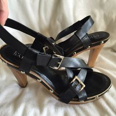 Franco Sarto strappy leather and wood sandals These shoes are in excellent condition! Genuine leather. Metal brads around shoe. 2 silver buckles. 8 M regular fit. Style L-Sayer. Made in Brazil. Smoke free pet free home. 4 1/4 inch heel. Sling back. Franco Sarto Shoes Sandals