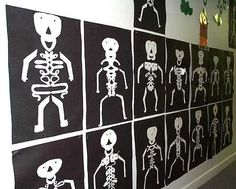 "Look closely: students folded white paper in half, wrote their names in cursive, and cut out around their names - this formed the body. They added the head, arms,and legs then mounted their ""name skeletons"" on black construction paper"