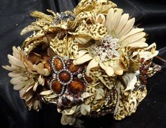 Leopard print wedding bouquet, leopard brooch bouquet, goth glam bouquet, feather bouquet, boho bouquet, 25% off with coupon code: BLING. $295.00, via Etsy.