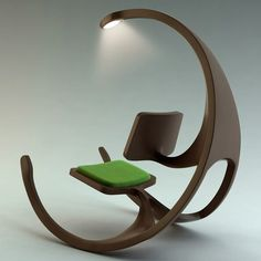 Just love this - imagine this for a reading chair. Not a wheelchair as the name suggest but a rocking chair. The Rocking Wheel-Chair
