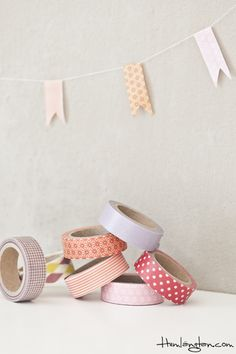 Washi Tape Mini Bunting on a length of twine - fold strips of tape in half and trim ends into flag points.