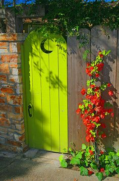 Crescent moon and bright green door.
