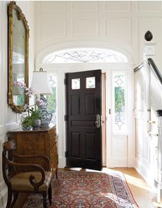 gracious foyer - don't love semi circle windows though