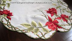 Society Silk table topper with gorgeous red roses.