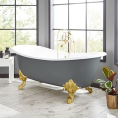 The Lena Cast Iron Clawfoot Tub will bring a new look to a timeless bathroom. The exterior is painted medium gray, which coordinates beautifully with the monarch imperial feet. Ideal for a large master bath, this tub has a double-slipper design that a Clawfoot Tub Bathroom, Master Bathroom, Vanity Bathroom, Blue Bathtub, Travertine Bathroom, Slate Bathroom, Stone Bathtub, Shiplap Bathroom, Washroom