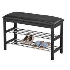 Complete your entryway and any other space of your home with this contemporary bench. Featuring a wooden frame and black bonded leather upholstery, this piece provides extra seating and valuable storage space.  $81
