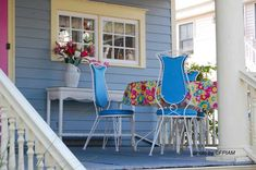 This lovely vintage table and chair set creates a useful outdoor room out of this small front porch! See more ideas: http://www.front-porch-ideas-and-more.com/victorian-porches.html
