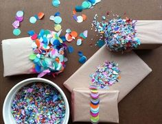 Wrap presents in tissue paper, cover with double sided tape, and dip into confetti for a multi-colored surprise.