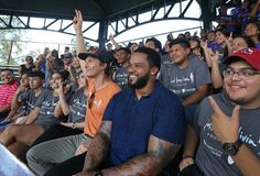 Matthew McConaughey and Prince Fielder pose for a photo with students to promote the Just Keep Livin' Foundation before the Angels vs Rangers game on Monday, September 19, 2016. (Louis DeLuca/The Dallas Morning News)