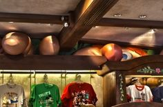 When you go to Sir Mickey's Shop in Fantasyland, look at where the roof meets the walls.  You will see Willie the Giant from Mickey and the Beanstalk peeking into the shop.  Most people don't even notice him!