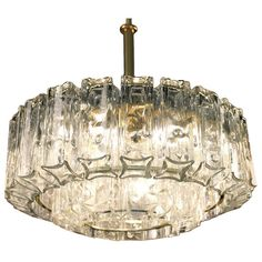 1960s Doria Crystal and Brass  Chandelier | From a unique collection of antique and modern chandeliers and pendants  at https://www.1stdibs.com/furniture/lighting/chandeliers-pendant-lights/