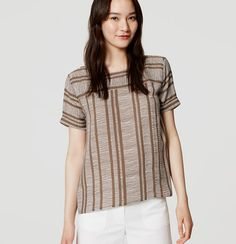 In exotic stripes, we're feeling the drapey cool of this roll-cuffed style. Round neck. Cuffed short sleeves. Front yoke. Shirred beneath back yoke. Hi-lo shirttail hem.
