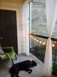 Great balcony decorations. Love the lights   and curtains!