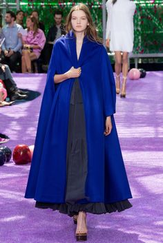 Christian Dior. Fall 2015 Couture. This has a Romantic period feel, because, in this look, the dress is draped with a cape-like jacket. During the Romantic period, mantles or cape-like jackets were worn because the sleeves were too large to fit into jacket sleeves. Vogue.com