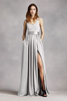 An exquisite gown that is perfect for a wedding party or any special event!  V-neck halter gown with matte crepe bodice features bow detail at back.  Long soft charmeuse skirt withmiddle slit an