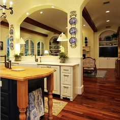 Traditonal with a litttle Country French. I like how the kitchen is open to the family room, but not too open.