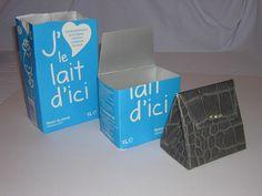 Il vous faudra : – Une brique de lait usagée – Du papier décoratif opaque – De la colle à papier – Une paire de ciseaux Source : L'atelier de Martine